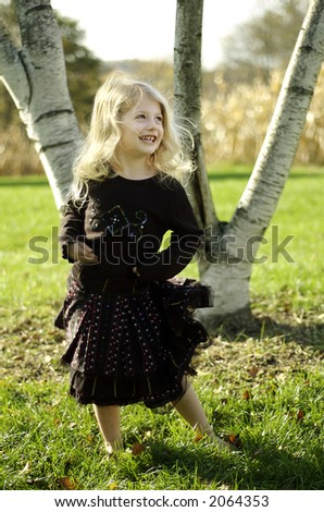 Girl dancing/playing/posing outside - stock photo