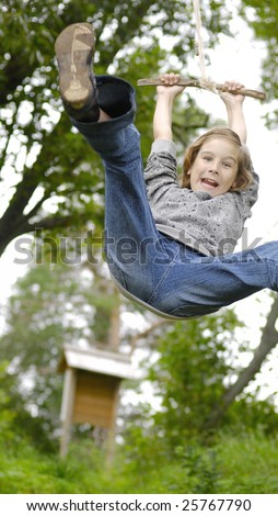 Girl  dangling in forest - stock photo