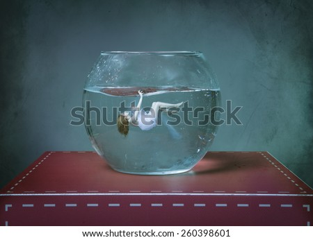 girl dead on a fishbowl - stock photo