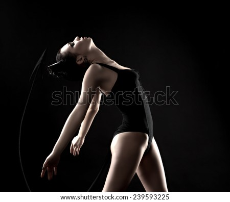 girl demon tail. to instill fear and panic sexy brunette devil. - stock photo