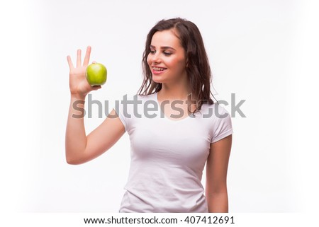 Girl demonstrate ok sigh with apple in hand - stock photo