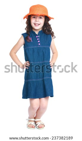 Girl denim dress sat poses for the camera.Isolated on white background portrait. - stock photo