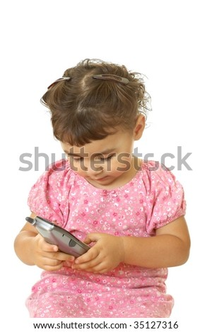 girl dialing telephone, two years old