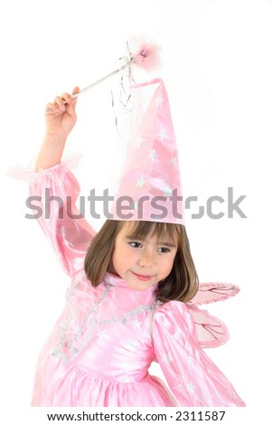 Girl disguised as fairy with pink dress and wand