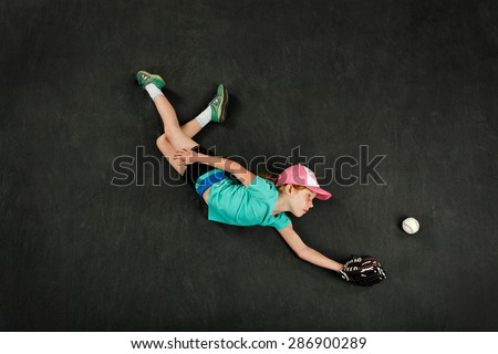 Girl diving for a great baseball catch - stock photo