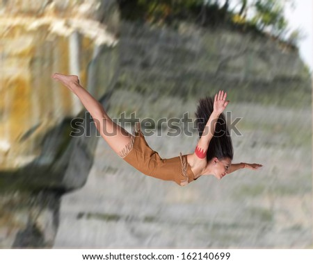 Girl diving off a cliff - stock photo