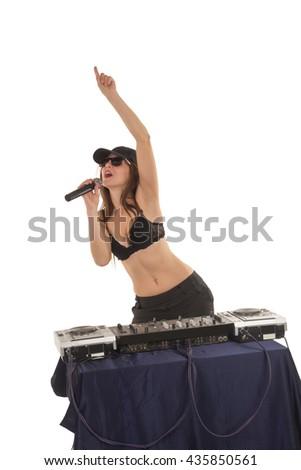 Girl DJ in the black bra is singing  - stock photo