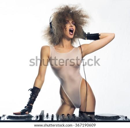 Girl - DJ in white Kombidrese, shouting - stock photo