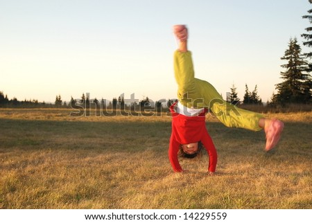 Girl doing exercise in nature - stock photo