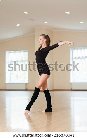girl doing exercises in a dance class - stock photo