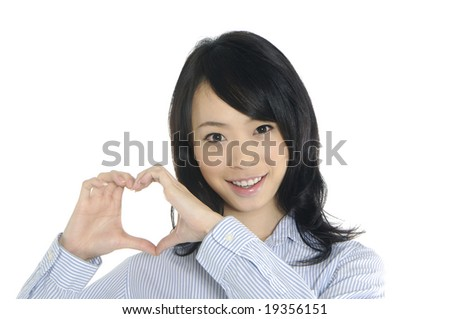 Girl doing hands forming a heart sign and smiling - stock photo