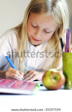 Girl doing homework - stock photo