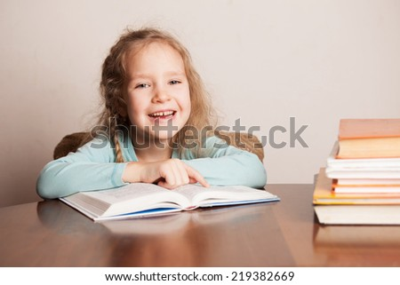 Girl doing homework. Child education - stock photo