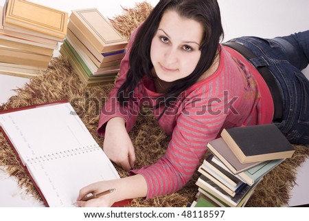 girl doing homework, standing the floor