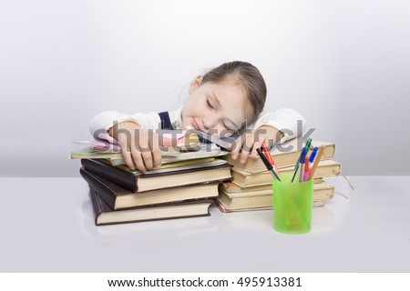 sweet little female latin child studying on desk lasking for help in stress  with a tired