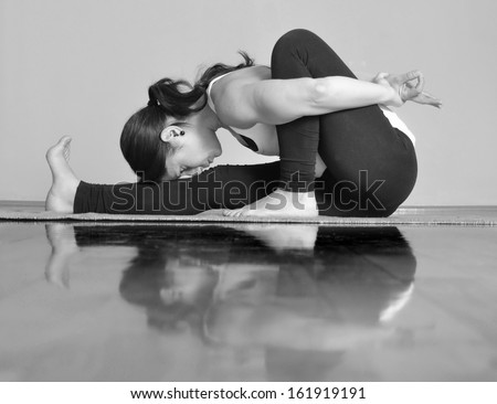 Girl doing Marichyasana A yoga pose - stock photo