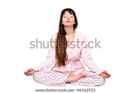 girl doing morning meditation and wearing pajama - stock photo