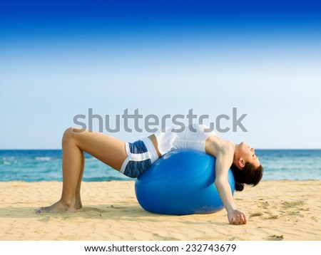 Girl doing pilates on the beach