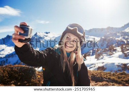 girl doing selfie mountains in the background - stock photo