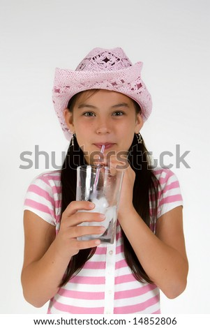 Girl draining water, dressed in pink - stock photo
