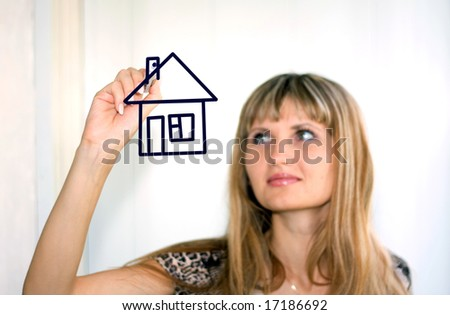 girl  drawing a house - stock photo