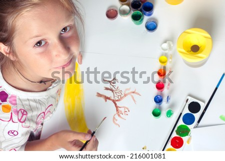 girl drawing on a white background  - stock photo