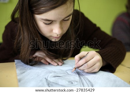 Girl drawing picture ( shallow DOF )