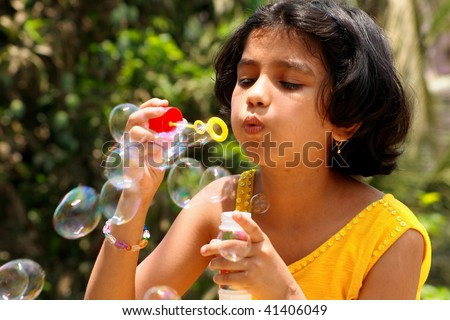 Girl drawing soap bubbles