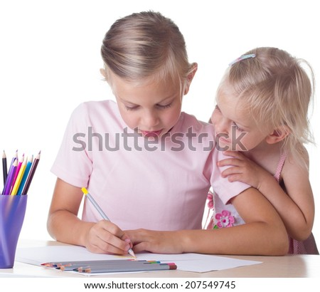 Girl drawing with his sister, isolated on white