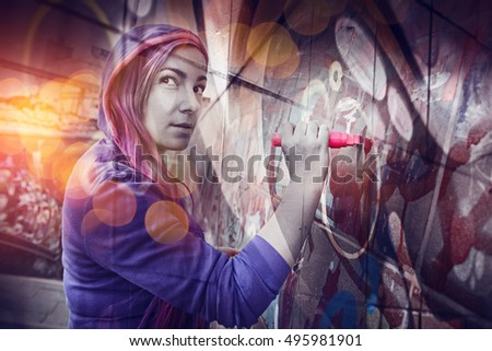 Girl draws a marker on the wall. painting graffiti.