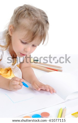 Girl draws on the album. Isolated on white