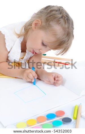 Girl draws on the album. Isolated on white background