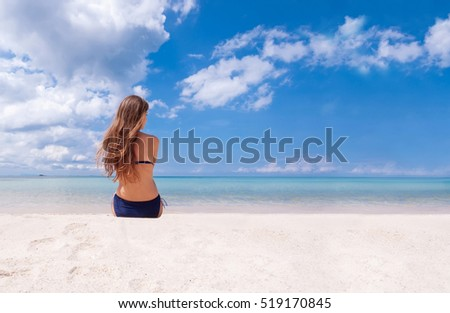Girl dreaming on the beach