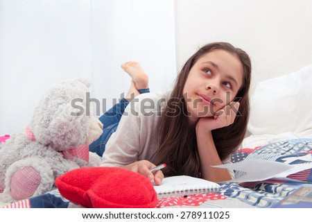 girl dreams lying on the bed - stock photo