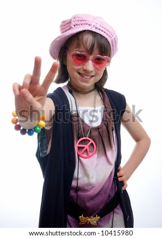 Girl dressed as a hippie chick gibing the peace sign