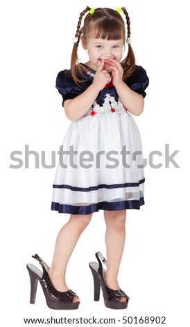 Girl dressed big mama's shoes, isolated on white background - stock photo