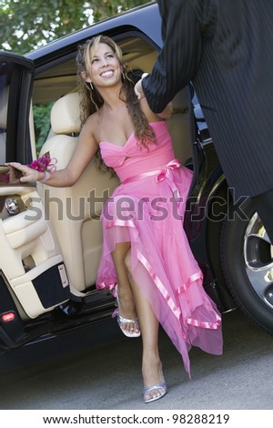 Girl Dressed for Dance Getting Out of Limo - stock photo