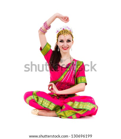 girl dressed in Indian costume with yoga pose.  Isolated on white background in full length.. - stock photo