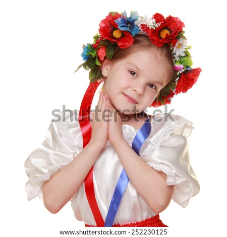 Girl dressed in traditional Ukrainian costume over white background - stock photo