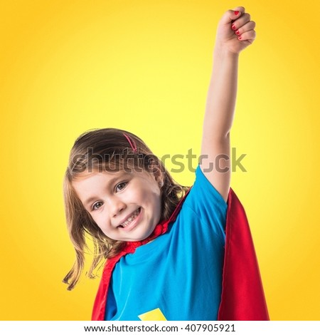 Girl dressed like superhero making fly gesture - stock photo