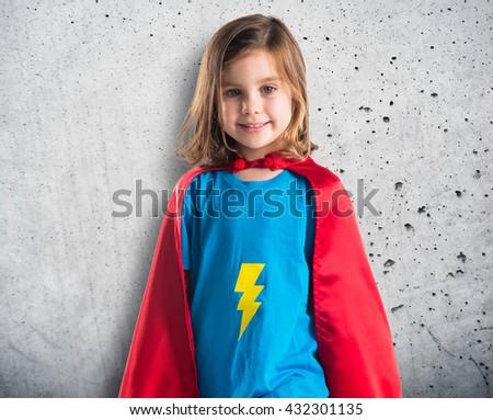 Girl dressed like superhero over grey background - stock photo