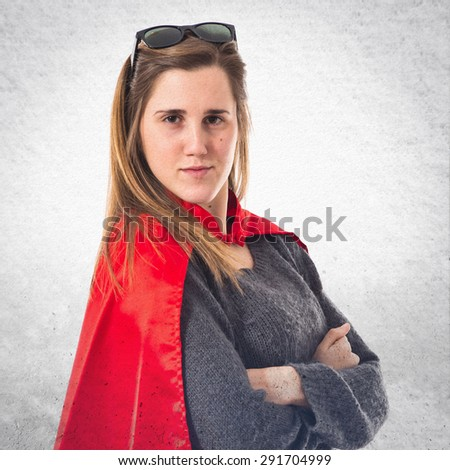 Girl dressed like superhero over textured background - stock photo