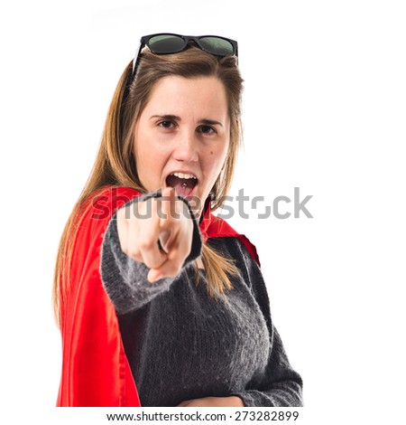 Girl dressed like superhero pointing front  - stock photo