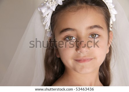Girl dressed up for her Holy Communion - stock photo