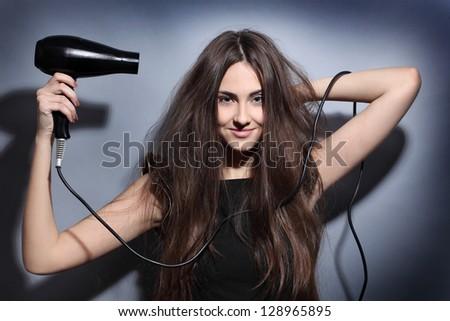 girl dries long hair hairdryer - stock photo
