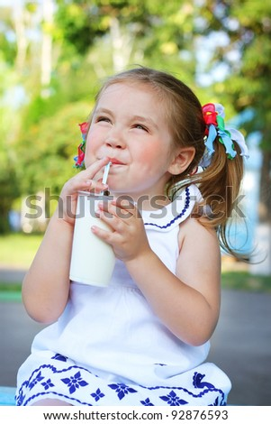girl drinking a milkshake - stock photo