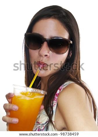 girl drinking an orange frozen drink - stock photo