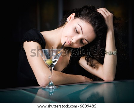 girl drinking cocktail - stock photo