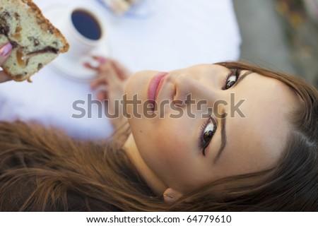 Girl drinking coffee - stock photo