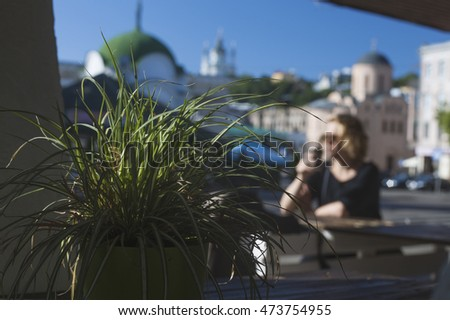 girl drinking coffee on city background blur